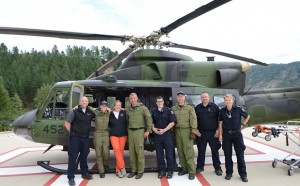 The aircrew of a CH-146 Griffon Helicopter from 408 Tactical Squadron take time to get a group photo with staff from the local hospital in Trail British Columbia as part of Exercise KOOTENAY COUGAR 2014 on 22 Aug, 2014.